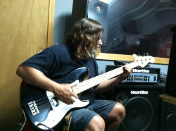 Bill Watson plays his Fender Precisionr Precision Bass through a Hartke bass amp