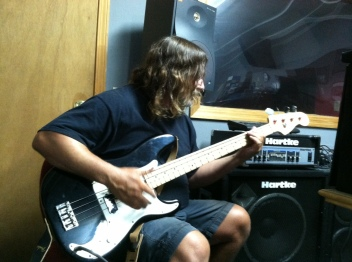 Bill Watson plays his Fender Precisionr Precision Bass through a Hartke bass amp