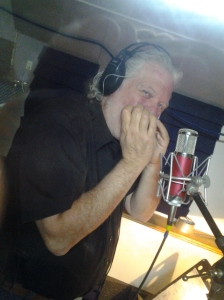 Nashville session musician Mike Douchette lays a harmonica track