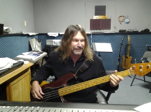 Bill Watson playing bass guitar with the guys from Mission 615