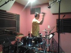 Rascal Flatts' drummer, Jim Riley, overdubs a tamborine part at Nashville Trax Recording Studio