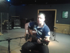 Dirk, one half of The father and son duo, the Jailbirds, tracking guitar