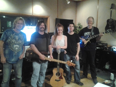 Grace Kelly of Wellington New Zealand doing a Nashville Trax recording session, L to Rt: L To Rt: Shawn Conley (engineer), Bill Watson (bass player & session producer) Grace Kelly (guitar, vocals), William Ellis drums, Tom Wild, guitar.